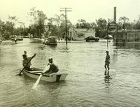 Two men rowing along Union Avenue in Framingham, Massachusetts
