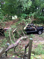 Car and property damage left by the overnight severe weather in Upton.