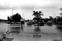 A flooded street off Great South Bay created by Hurricane Belle. Boats appear to be tied up in the town of Brookhaven, Long Island, New York on Aug. 10, 1976