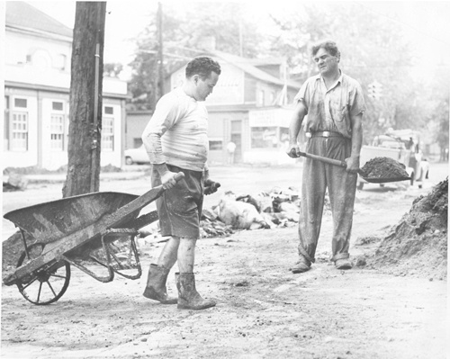 Shorts-clad Filmore German, right, owner of Lackawanna Bakery, 424 S. Washington Ave and Anthony Gatto, 306 Franklin Ave, between what's on the ground and what's on them, these two men have seen enoug