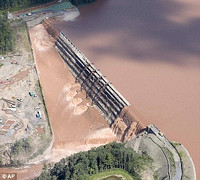 Catastrophe, before and after: The Gilboa Dam in upstate New York was heavily damaged after Irene tore through the area