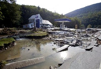 flooding is seen near the Irving gas station at the junction of Route 4 and Route 100 in in Killington, Vt