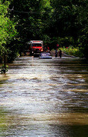 This car had to be rescued from the wrath of the Still River along Cross St., in New Milford, the occupant was rescued earlier