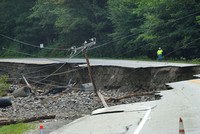 Road crews evaluated the flood damage to Route 4 in Mendon, VT